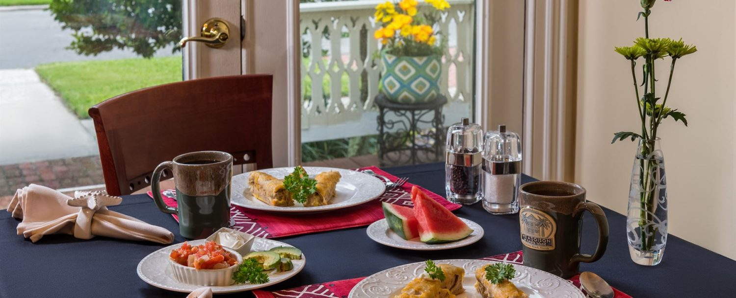Breakfast plated for two on a dressed table at The Addison on Amelia Island