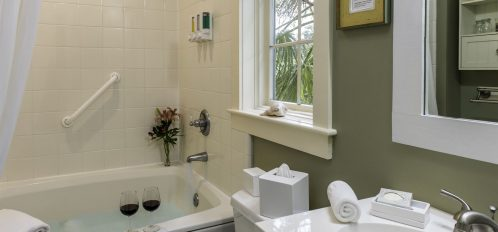 Room 14 at The Addison on Amelia Island - Bathroom with tub and shower combo