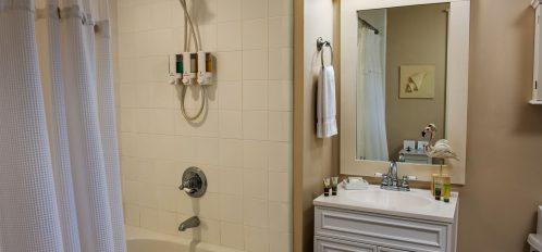 Room 7 at The Addison on Amelia Island - bathroom with shower and bathtub combo