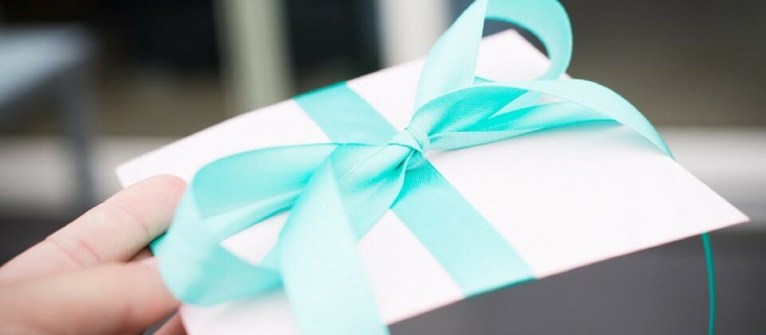 Beautifully wrapped gift in envelope