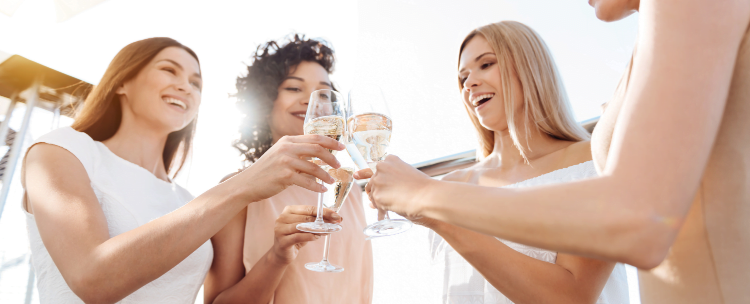 women cheersing together on their Florida bachelorette party