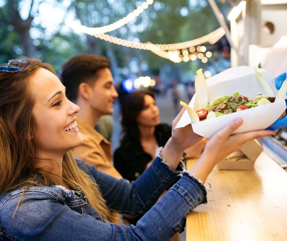 Woman getting food at a food truck