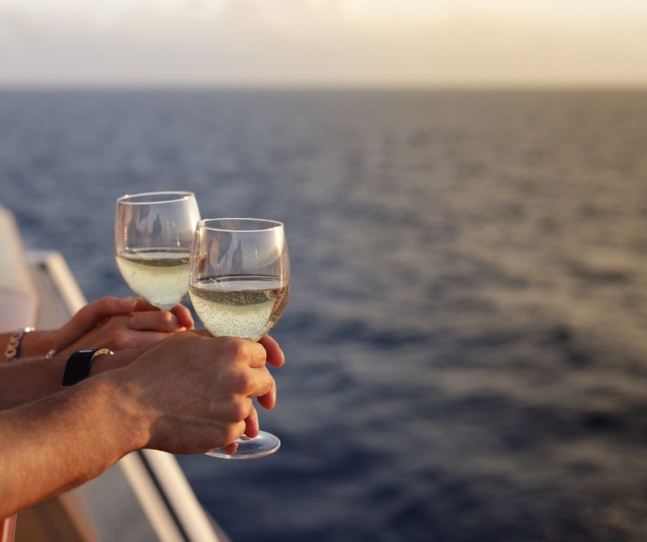 People drinking wine on a sunset cruise