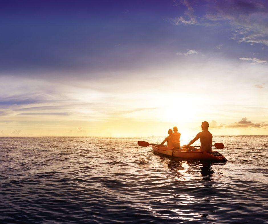 People kayaking on the ocean